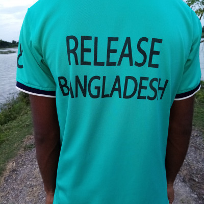 In this picture you can see a member of Bangladesh Release Group wearing a genji of the release company and he is standing on the street of Jiala village. You can see a picture of him in this picture.  And he wore a LS company genji on his body and came to visit in the afternoon and you can see a picture of him.  And he posts very nicely and he went out for a walk in the afternoon with the vest given to him by the release company and this picture was taken from the back and the line on the back is Release Bangladesh because this vest has Release Bangladesh written on it so that people can recognize that this vest is released.  From the company above, Eeriliz Bangladesh is written on the back of this genji and there is an inscription on it and the scene of this boy you can see in this picture looks very awesome.  The boy posted nicely in order to get good points and how to post according to the rules and this boy went out for a walk on the street in the afternoon wearing this release vest and you can see a picture of him in this picture.  It looks beautiful.