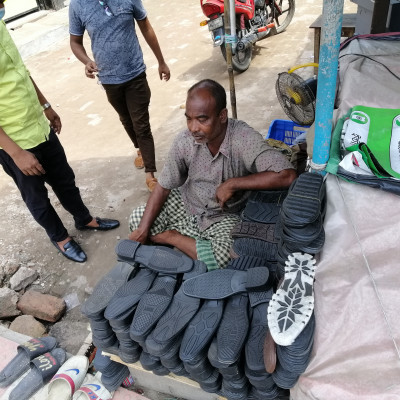 Here you can see a Muslim man repairing shoes in this picture. He is sitting at the corner of New Market of Satkhira Sadar Police Station and his shop is very strong. He is an honest man and his working father will go to his shop for him