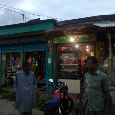 Friends, the shop you are looking at has two or three shops.  One is a food shop and the other is a sweet shop. There are some people standing in front of the shop.  This photo was taken from Dhulihar Bazar, Satkhira District, Bangladesh.  You can see in the picture that there are two shops selling food in one of them. There are all kinds of food in this shop like biscuits, chocolate, juice, salty boots etc. And there is a sweet shop next to it.  This is one of the most popular foods.  Everyone likes to eat sweets.  So he is small and big. And no matter where the shop is crowded or not, the sweet shop is always crowded.  Again there are many people who like to eat sweets all the time.  This sweet shop has yogurt, rasogalla, sandesh, jilapi, white and black sweets, etc.  People like sweets a lot more than Jhak.