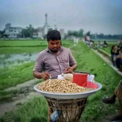 He is looking very nice.  Turns out he sells it with great difficulty. He is seen standing in the sun all day selling nuts and earning some money to spend on his family. This man is seen working hard.some nuts. He is looking very nice.  Turns out he sells it with great difficulty. He is seen standing in the sun all day selling nuts and earning some money to spend on his family. This man is seen working hard.some money to spend on his family. This man is seen working hard.some nuts. He is looking very nice.  Turns out he sells it with great difficulty. He is seen standing in the sun all day selling nuts and earning some money to spend on his family. This man is seen working hard.