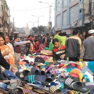 There's a shoe store on the street. There's a lot of shoes. There's a lot of people. There's a lot of people. There's a lot of people. There's a lot of people here. There's a lot of people here.  There are people who are selling shoes and buying shoes from here at low prices. It is actually a very beautiful place in Dhaka city inside Dhaka district. Shoes are sold from the shoe shop on the ground and it is sold. You can buy shoes from here.  This place is very good for taking and using very nice good shoes for a low price inside