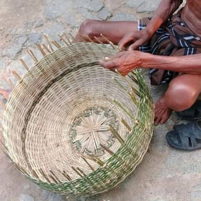 Here it is seen that a person is making jhuriwhile sitting. It looks very beautiful. The method of making this dhari is very beautiful. In fact, it is seen here that he is making baskets while sitting. I make baskets very carefully.  It is used for various purposes in Bangladesh and is used to carry different thingsmake baskets very carefully.  It is used for various purposes in Bangladesh and is used to carry different