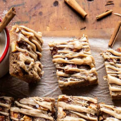 "If there was ever a recipe that screams fall, it's these soft and gooey Brown Butter Apple Blondies with Cinnamon Maple Glaze. Made with nutty browned butter, salted apple butter, cinnamon, and nutmeg. Then generously glazed with a sweet, thick, and creamy cinnamon maple glaze. There's really nothing not to love about these autumn spiced apple blondies. The true secret? Brown butter and sweet apple butter. They keep these blondies incredibly flavorful, soft, gooey, and so delicious. The added bonus is that these bars require almost no effort to make. They're sweet, salty, heavy on the apple butter, extra cinnamony, and every last bite is truly delicious.  overhead photo of Brown Butter Apple Blondies with Cinnamon Maple Glaze  We're going on a three-week roll of Friday apple desserts and I'm not seeing an end in the near future. Well, ok. I'll probably switch it up next Friday, but my point is that I have so many fall apple recipes written on my ""to make"" list. I plan to make as many as I can.  I was worried you guys would be sick of apples, but after a quick poll on Instagram earlier this week, you all assured me that the more apple recipes the better. YES. I am so with you guys. I think I said this last week, but September is apple month, save the pumpkins for October and November, you know?"