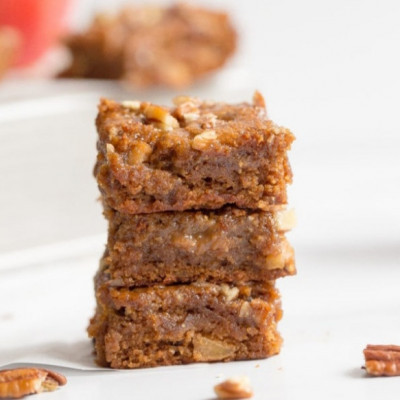 Let's welcome the beginning of September with Apple Pecan Blondies!! These delicious treats are here to remind you of all things cozy when it comes to fall flavors: chopped apples, cinnamon, pecans, and maple syrup are all included in these yummy blondies. Paleo, Gluten-Free, but loved by all. Grab your apron and let's get in the baking mood!  Let's welcome the beginning of September with Apple Pecan Blondies!! These delicious treats are here to remind you of all things cozy when it comes to fall flavors: chopped apples, cinnamon, pecans, and maple syrup are all included in these yummy blondies. Paleo, Gluten-Free, but loved by all. Grab your apron and let's get in the baking mood!  Allow me to introduce you to your new fall favorite breakfast, midday snack, and evening treat: Apple Pecan Blondies! Dense and moist squares with the yummiest hints of apples, cinnamon, crunchy pecans, and a maple syrup glaze to top it all off. These amazing treats are warm, simple, and cozy in the best way possible. If I could reach through the computer or phone and give you a hug, it would taste like a bit of these blondies! You get the idea. So why blondies? If you've been a Wholesomelicious follower for sometime, you know that I am much more of a chocolate girl. Brownies are my best friends. In the past few years, I've found a new love for blondies (the sweeter, vanilla flavored sister of a brownie). My Pumpkin Blondies and Banana Bread Blondies are 2 of my favorite desserts on my site! Although my love for brownies will always be strong, I am currently loving the many different flavors of blondies I can come up with.
