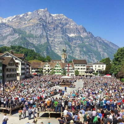 There are some mountainous areas in Switzerland that can be visited and enjoyed innumerable pleasures which cannot be overstated. In the picture you can see that thousands of people are standing in this hilly area. Different types of festivals are organized in these hilly areas at certain times of the year. Millions of people from this country take part in those festivals. People from other countries, especially tourists, travel outside the country to take part in these festivals. It's really nice to see millions of people gather here. Everyone participates in this festival and plays a role in performing these sacred functions. The greenery of these mountains gives people a lot of joy so people go here to travel.