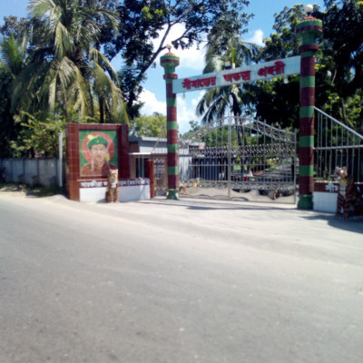 Picture taken from the road.  Here is the gate of Bangladesh Border Guard.  It is very beautiful to see the picture taken from the roadside here.  A giant gate can be seen here.  It was taken from a road in Mill Bazar area of ​​Satkhira district.  The picture can be seen here and it is the entrance of Bangladesh Border Guard.  It looks very beautiful to play the role of vigilant guard of the border of Bangladesh.  And they play a role in maintaining law and order in Bangladesh.  Here you can see all kinds of people walking through the gate.  And it has made a beautiful gate to make one in front of the main camp.  This is a view of the Bangladesh Border Guard Gate taken from the Mill Bazar area of ​​Satkhira district.