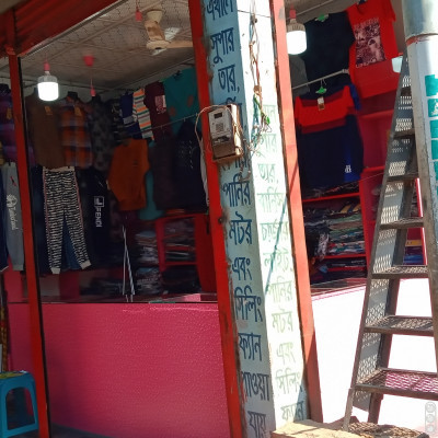 Here I put a picture of a shop in front of you.  That shop is a clothes shop.  Only different types of clothes for boys are sold here.  For this there is no crowd of girls here.  And the boys they meet their clothing needs from here.  Since all the clothes for the boys are sold.  That's why more boys come here.  And here clothes are sold at affordable prices. That is why the number of buyers is much higher.  They bought clothes from here and took them away.  And more are sold here.  Trousers are sold more here.  All the clothes you need to play sports are available here.