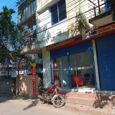 There is a building you can see here.  It is very nice to see the handsome building.  And this building has become colorful.  And the owner lives upstairs in this building.  The shops below have been rented out. The shops have been rented out.  One store is closed.  Nothing I know about this store.  I can't explain anymore.  There is another shop next to it.  Which is open.  Different types of activities are being conducted as well as different products are being sold.  And in this shop various products and goods are sold.  And you can see in front of this shop that there is glass.  Which has to be penetrated and if there are different goods.  They are sold.  You will see them.  Hopefully I was able to present the matter.