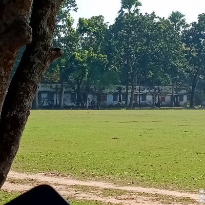 Here you can see a field that has green grass on the field.  Which makes me feel much better.  And there is a building you can see in the distance.  That building is much larger in size.  Which are spread across many places.  This is called a hostel.  College hostel has been built here.  Those who study in college.  This hostel has been arranged for those who come from far and wide.  So that you get all kinds of opportunities to stay and eat in this hostel.  It has been done.  And it has become ancient.  Made a long time ago and eats a lot better.  Lives well and can study well there.  That is why many have started staying in hostels.  They are studying in a hostel and they do all kinds of work.  They are very happy in the new environment.