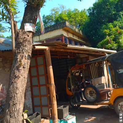 There is a garage here.  In that garage you solve problems with different types of vehicles.  Here you can see an easy bike has been put in the garage.   Because this is a problem.  Which has come to this garage to solve the problem and these vehicles are fixed.  Is repaired.   Even bicycles, bikes have all kinds of vehicles.  Where problems are solved and everything is repaired.  Much better work is done.   If its work is good then there are many garage works available here and they have repaired these vehicles.  A little better relationship is formed between them.   This way it can become a much better garage.  Hopefully.  You can see there is a building.  Lives where self-made.