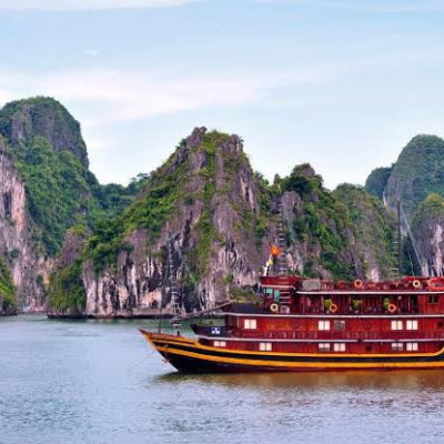 Ha Long Bay is located in the province of Quangni in Vietnam.  Halong Bay is named after the city of Ha Long.  The area of ​​the bay is 1553 sq km.  Its clear blue water contains various types of limestone, which has enhanced its beauty many times over.  Innumerable hills of these limestone after a while in the bay.  There are about 1,960 to 2,000 small islands of limestone.  However, the area of ​​the main part of the bay is 334 square kilometers.  The average temperature here is 15-25 degrees Celsius.  Ha Long Bay has 928 islands.  However, there are only two large islands.  There are four floating villages in Halang Bay.  The villages are known as 'Kua Wen', 'Ba Long', 'Chong Tu' and 'Ha Long City'.  Almost all of the inhabitants are fishermen.  The bay was recognized by UNESCO as a World Heritage Site in 1994.  The Vietnamese word 'ha long' means 'dragon descending to the ground'.  The Vietnamese call this bay Vin Ha Long.   Research has shown that people started living here 10,000 years ago.  Hang Du Go is the largest cave here.  It is an artificial cave covered with a wooden roof.  In the nineteenth century, French tourists named it Grotte de Marvelles.  It is arranged in three huge chambers.  Drop by drop of water falling from the roof of the cave has taken the environment of the cave to a different level with the numerous hanging and earthen pillars of limestone.  Tuan Chou and Kat Ba are the largest islands in Ha Long Bay.   Cost  Different tour companies from Hanoi have different packages for Halong Bay.  Starting at just $ 30.  If you want to go privately, you can take a bus or a minibus from Hanoi.  The minibus will cost you 120,000 dong or 6  You can also rent a private car or taxi.  For this you have to pay 85 dollars for each car.  If you rent the whole trip for 2 days and 1 night, the cost will be  $ 150.  The best time to travel,  The best time to visit Halong Bay is from March to June.  If you want to travel in solitude, it is better not to go on public holidays in Vietnam.   How to go,  There are no direct flights from Bangladesh to Vietnam.  First you have to go to Hanoi, the capital of Vietnam, via transit to Malaysia or Singapore.  Halong Bay is 180  kilometers from Hanoi, Vietnam.  It takes a total of eight hours to get there and back.   Where to stay,  There is a floating hotel 16 kilometers from the landlocked part of Halong Bay, where you can spend the night in the heart of the mountainous bay.