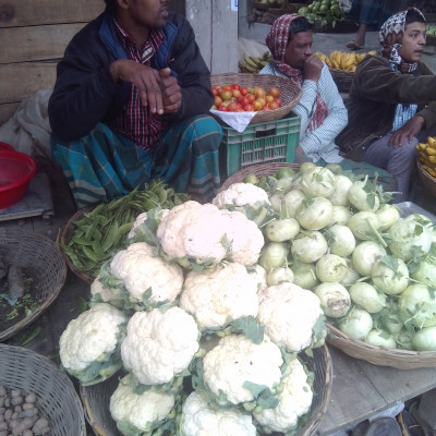 It is very good to cook and eat vegetables.  The people of Bangladesh love to cook and eat vegetables.  Moreover, vegetables contain a lot of vitamins, so we should eat more vegetables.  In the picture you can see a man sitting in the market selling vegetables.  Here it is seen that the man is selling a variety of vegetables which are very nice to look at.  Here you can see cauliflower, cauliflower, cabbage, potatoes, gourds, tomatoes and many other types of vegetables that are very good to eat.  I find it very nice to see the vegetables in the vegetable shop.  I hope you find it very nice to see the vegetables in the vegetable shop.  To be honest, it is very good to cook and eat green vegetables.