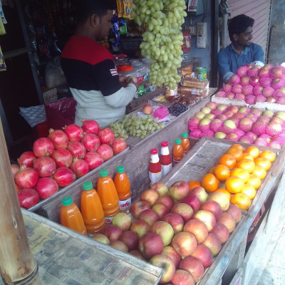 The people of Bangladesh love to eat fruits.  Because the result is a lot of vitamins.  We should eat more and more fruit.  You can see in the picture a fruit shop.  Here you can see a variety of fruits that look very nice.  Moreover, it is very good to eat such fruits.  The picture was taken from our Chandpur market which is why it looks so good.  I find it very nice to see the fruits in the fruit shop.  I hope you enjoy the fruits of the fruit shop.  Here we can see that there are different kinds of fruits like apples, oranges, pomegranates, grapes and many other kinds of fruits which are very good to eat. I think we should eat more of these kinds of fresh fruits.