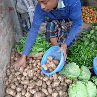 We have a variety of vegetables in our daily diet.  We can see a vegetable market in the picture here.  It is located in Dharmapur Bazar of Satkhira district.  We can see the scene in front of the store.  A variety of vegetables are arranged in front of the vegetable shop.  And we all like to eat vegetables.  Because vegetables have a lot of nutrients.  And we keep vegetables in our daily diet.  Here in the picture you can see the vegetable shop scene.  And we should eat lots of vegetables.  Because vegetables have a lot of nutrients.  And eating vegetables is much better for our body.  To keep the body healthy properly, we should eat plenty of vegetables.  Here you can see the view of the vegetable shop located in Dharmapur Bazar of our Satkhira district.