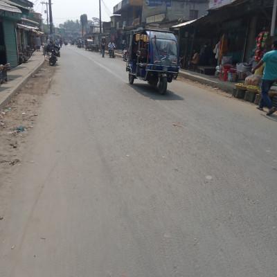 Easybike is the best means of transportation from Kaliganj Upazila to Satkhira district town.  We can see an easybike in the picture here.  It is located in Kaliganj market.  When we left Kaliganj for Satkhira city.  Easybike is one of the vehicles that comes to our notice then.  Kaliganj Upazila area has a lot of easybikes.  A vehicle that is very comfortable and fast.  That's why we love to travel easybike.  Easybike has a very nice seating arrangement and can be seen in abundance in Satkhira district town. We travel from Kaliganj to Satkhira town and the road in Kaliganj upazila area is very beautiful.  The driver can drive very well and many drivers earn income by driving. Many young boys of Satkhira district do it every day and many youngsters help their families financially by riding easy bikes and many of them are benefiting financially by hesitating.  You can earn up to a thousand rupees so you are very interested in riding an easy bike. Young boys are seen in this picture. This picture was taken from Kaliganj Bazar Road.