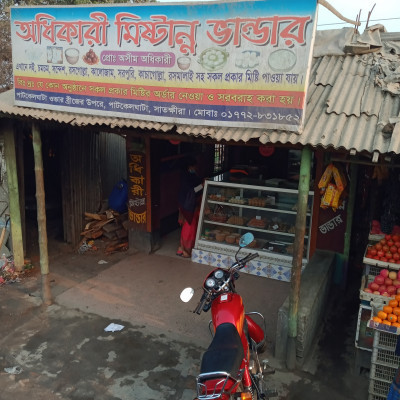 I took the picture when I was coming to Satkhira by bus.  And in this picture there is a sweet shop. Where all kinds of sweets.  Which is everyone's favorite food.  And it has a lot of nutritious calcium and vitamins.  And this is the shop on Patkelghata Over Bridge.  And people eat sweets from here while moving.  The demand for sweets is much higher.  Black jam sweets, rasgolla, sandesh, rasmalai, black and white and many other sweets are made and sold here.  For which everyone eats and praises them.  These are delicious food.  Eating these also increases our brain power.  So much usefulness and more so its demand is more.  The name of this sweet shop is Adhikari Confectionery.  And it falls in the country of Satkhira.