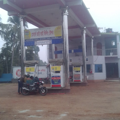 Messrs. Bhai Bhai Filling Station.  In the picture you can see Messrs. Bhai Bhai filling station.  Cars, motorcycles, trucks, buses, all car oil, diesel, petrol are available here. It is a filling station in Satkhira district. In the picture you can see but a motorcycle bike is taking oil from the filling station.  Almost regularly takes oil.  The picture is taken from our Dhulihar market which is why it is very nice to see the picture. Such a filling station can be seen in very few places in Bangladesh. It costs a lot of money to build such a filling station.  I'm glad to see the filling station.  I hope you enjoy the filling station. Besides, there is only one filling station from Satkhira district to Budhahata.  That is why this filling station is very convenient for those who travel by car on the road. I hope it is very good to see the picture of the filling station.