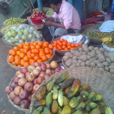 In the picture you can see a man sitting in a market selling different kinds of fruits.  Here you can see a variety of fruits such as apples, oranges, cool and many other types of fruits that are very good to eat.  The people of Bangladesh love to eat such fruits.  Moreover, such fruits are rich in vitamins.  That is why we should eat more and more of these kinds of fruits. In fact, it is very nice to eat and see such fruits.  The picture was taken from our Budhahata market which is why it looks so good.  We should always eat fresh fruit roots as they contain a lot of vitamins which are very necessary for our body.  I am very happy to see the fruits of the man. I hope you are very good to see the fruits of the man.  Moreover, to be honest, the fun of eating such fruits is different.