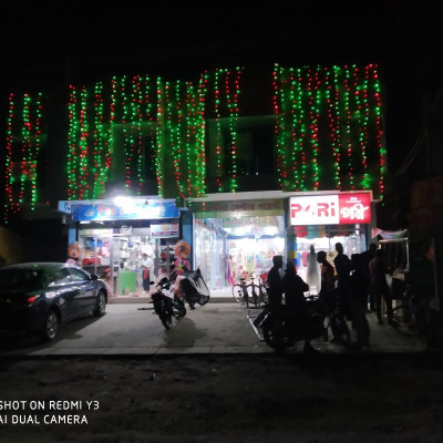 Beautiful is a large shopping mall located on the north side of Satkhira PN High School and it is a beautiful mahal established in the year 2018 and the name of this shopping mall is Satkhira Center Point and this shopping mahal has three locks left and here you can find various items including cosmetics and go shopping at night.  I took a picture of this mahal and posted it among you and there is a beautiful road in front of the mahal  A few motorcycles and a few bicycles are parked and there are a few people standing and the shopping mall is divided into two parts and the left side and the front are surrounded by beautiful glass and inside it children play various types of toys and all kinds of cosmetics.  Inside the barn and shop a few people are shopping or standing there and the part on the right side of the shopping mall and here the goods are sold and there is a one to enter the mahal.  There are many T-shirts, belts, pants, etc. on the right side of the road with beautiful ties on the road and on the right side of the road you can see women's sarees, thrips, etc. with some manny queens etc.