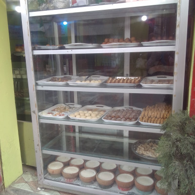 The picture shows a sweet hotel in Satkhira.  Here you can see that there are different types of sweets in a glass.  The people of Bangladesh like to eat such sweets. Here you can see different types of sweets such as rasgolla, gaja, jilapi, yoghurt, sandesh and many other types of sweets that are very good to eat.  Moreover, sweets are very good for health, so we should eat more sweets.  Because sweets are very good for the body. The picture was taken from Satkhira which is why it is very nice to see the picture. I like to eat and see the different kinds of sweets kept in the glass.  I hope you enjoy the sweets in the glass of the hotel.  Moreover, to be honest, such sweets are very good to eat and the fun of eating them is different.