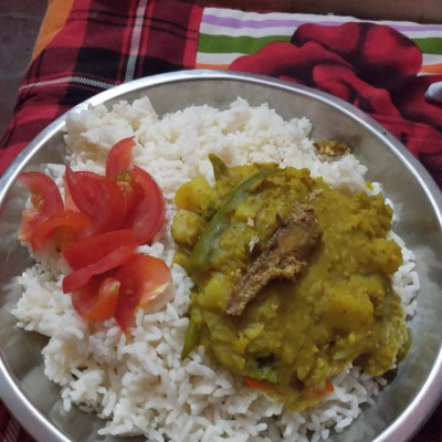 the picture  is  rice,dal,tamato.it is a good food in bangladesh people.red coler food is tamato.the whait color  food is rice.rice is importent food in bangladesh people.we can not live with out rice.it is our main food.the yellow  color  food is dal.it is a very good food for poor people.So ths picture is very importent for our Bangladesh people.the plat has rice,dal,tamato.the food is night denar.all people eat the food.so the food need in our body.we can not live without food.Bangladesh people eat the food everyday..we love this food.so bangladesh people like this food.