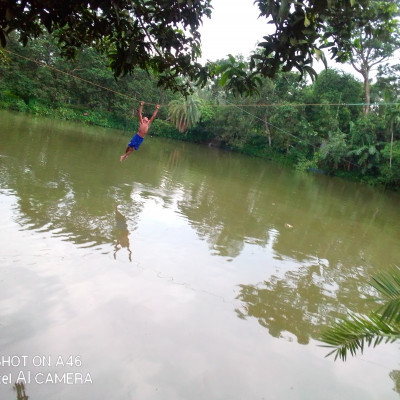 It is seen that a boy is trying to cross the pond with a rope to cross it and it looks very beautiful. There is a very beautiful nature around it. If he can cross the pond with a shave, he will be rewarded.  It is a very difficult game to catch and it looks very beautiful. This is a game that people in our rural areas of Bangladesh play this kind of game and it is very beautiful. This scene is a beautiful sport in most parts of our Bangladesh.  A game and it turns out that to do this game a boy is trying to run across and there are a lot of people standing around to enjoy this game and it looks very nice this scene is a game in our rural area