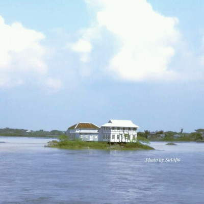 This small house is located on the banks of the river Padma.  Very nicely built this house with tinset.  Looks very interesting from a distance.  In the southern region of my home I enjoyed this beautiful view while heading north.  The Padma is the only means of transportation from the south to the north.  We enjoy a variety of views while crossing the river.  All of a sudden I saw this beautiful house and immediately took the picture.  It is very beautiful to see this house along the middle of the river Padma.  I don't know the name of this village.  But I really like seeing this little house.  But the wonder is how beautifully people live here underwater to build this house.  How the people travel in the water is flowing around.  Only those who live can tell.  The life of the people living on the banks of this river is like the life of many people living in this poor country of ours. Only they can tell how they live and from a distance we can only see because we do not live near such rivers.  The river is a few miles away from there, so the riverside life is like the life of a river-dwelling people. Only those who live can tell. We can only see from afar. Our country is a very poor country.  Life is going on.  The river Padma is a very big river.  Many small and big scenes like this come to our notice while traveling along this river.