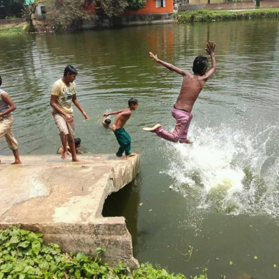 These little boys are bathing in Kukrali, Satkhira.  Childhood mischief I feel very good in the middle of the afternoon to see that mischief.  I was standing and enjoying them while they were jumping into the water.  I remembered my childhood memories.  As a child, I used to bathe in the pond with my cousins ​​like this.  My nanubari has a paved pond.  My nanubari has many paved ponds.  Inside, we used to go to a pond one by one and play water games with our cousins.  It was one of the fondest memories of my childhood.  I can't get back to those days. Everybody goes away and never comes back. Childhood mischief can only be done. When I grow up, the environment changes around us. Now I'm transformed into a perfect human being.  Seeing their mischief reminds me of my childhood memories.  These boys are playing water sports with great pleasure.  Jumping in the water. In the mid-afternoon heat, they are enjoying the water very much. They have been swimming for a long time. I also swam many times in my childhood.