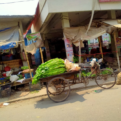 The picture presented here is captured by me at the time of coming back from Satkhira District. There is a van on which there are some basils. There are other stalls in which there are various kinds of goods or commodities. There are basils, potatoes, ginger and what not. The goods or commodities are nicely arranged here. I feel well seeing the sight.  I wholeheartedly besought to capture the picture so that I can post it in Release Bangladesh and I instantly captured the picture according to my desire.  I hope you will able to buy your  daily necessaries or commodities from these stalls.