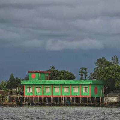 This beautiful red and green building is located in Tangua Haor.  It turns out to be a residential building.  These buildings are mostly rented to tourists.  Because it is a tourist destination, Tangua Haor is a very popular place for tourists to enjoy the beauty of Tangua Haor. Tourists from far and wide come here from far and wide. The people of this house stay in this house for a few days.  It is very nice to see such a Bangladeshi in the midst of the beautiful nature outside the whole house shining in the sunlight on the green chest. It would be nice to see this flag of anyone and especially wherever we Bengalis go. We love to see this flag in our own tourist area.  It would be nice to see a house of this beautiful color and a house painted in the shape of our flag, and if we could stay in that place, it would make us more happy in this beautiful place.