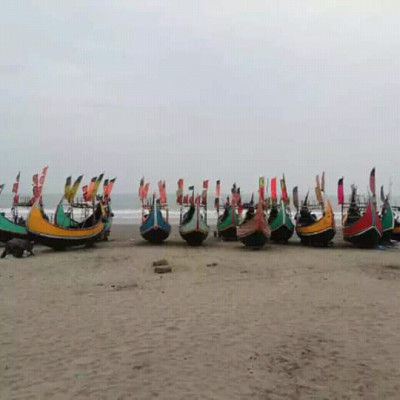 Many colorful boats can be seen lined up at Cox's Bazar Himchhari seaport.  These boats are called Sampan.  Because once upon a time there was this sampan in the Persian Gulf.  Now the sailors in the sea of ​​our country continue this sampan.  With this sampan, most of the sailors fish and many of the passengers cross.  It is seen that one person is taking down the net from Sampan.I went on a trip to Cox's Bazar last week.  I have seen these beautiful resources while traveling there.  I like it very much and I love all the colors that are so beautifully lined up on Himchhari beach.  I like it a lot. I have spent a lot of time sitting on this sampan. There is one of the beauty of spending time sitting on the sampan on the beach.  I enjoyed this time more and more and I enjoyed the beauty all around. The vastness as far as the eye can see is just water and water and if there is such a beach to enjoy the beauty, then you can sit there and enjoy it better.  A very beautiful boat and it would be better if these boats sailed on the sea, but I did not have that luck. I could not get into the sea with this sampan because I am afraid of the water so I just spent time sitting on this sampan.