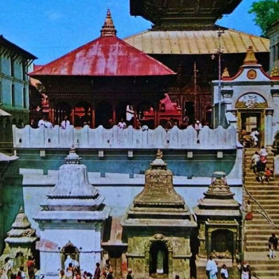 Here we can see Sri Pashupatinath Temple. It is an ancient temple. This temple seems to be a witness of history. It is located in India.  This temple is an aesthetic beauty.  The designs of each of its works are very beautiful. Regular worship is performed here. It is a place of pilgrimage.  Here we can see the staircase attached to the temple with a pond. That is to say, the devotees worship from here to worship in the temple. It is a very beautiful place. Devotees come here from far and wide to worship. They offer offerings in the temple.  Famous temple. This is how the gods and goddesses of the temple are worshiped here.