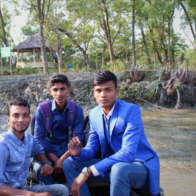 We can see that we are sitting where the three friends are sitting but on the other side of the Sundarbans i.e. the Sundarbans but from there it is seen behind us but the Sundarbans is here. There is a lot more next to me.  I went to the Sundarbans to walk around, we actually have a lot of fun walking around the Sundarbans and we see a lot of things inside the Sundarbans. I can't tell you what a beautiful place where our natural beauty is hidden.  The Sundarbans is such a beautiful place with a variety of trees and plants. The clock will always be remembered by our three friends. It will be written on the pages of memory. We will never forget the day.