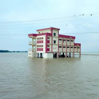 Floods are a natural disaster.  Floods are common in Bangladesh.  These floods can be due to various reasons, such as river erosion and heavy rainfall.  The picture shows a large amount of flood water in one place.  It is seen that a school has been submerged due to flood waters. This school was built in a field.  Suddenly the floodwaters rose.  This is a very bad scene for the people of our Satkhira district.