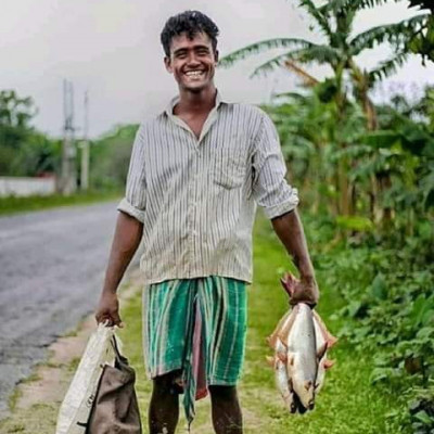 The smile on the man's face shows that he is very happy. Such a happy smile cannot be bought even with crores of rupees. He is a fisherman. Fishing is his only job. He can run his family with the money he earns by selling fish.  He is going home with some fish and bags in his hand. He may be poor but he is never unhappy.