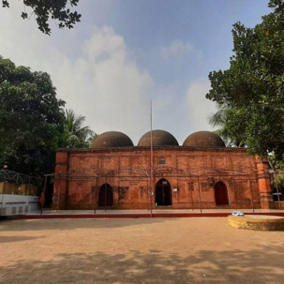 The historic Chatmohar Shahi Mosque is one of the most iconic architectural structures in the heart of Chatmohar Upazila, 5 km away from Pabna district.   According to the inscription from the mosque, during the reign of Emperor Akbar in 5 AD, his brother Muhammad bin Turki Khan built the historic mosque at Kakshal Chatmohar, with the help of Syed leader Abul Fate Mohammad Masum Khan.  The construction of the three-domed Chatmohar Shahi mosque has the influence of ancient Sultanate architecture.  The Chatmohar Shahi mosque, constructed of small jaffery bricks that resembles the Kherua Mosque of Bogra, is 8 feet in length, 22 feet 3 inches in height and 5 feet in height.