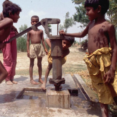 A typical picture of the village.  The people of the village depend on the water of this tubewell.  They wash their feet in ponds or river water and use this water for food.   The image of children and water taking in the water shows that it is not just water thirsty, it is also a part of their sport.