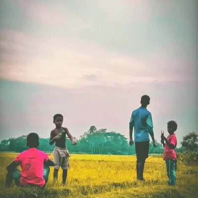 As a child, I loved flying kites.  We flew a lot of kites in our childhood. The picture shows some boys flying kites in a field. It looks very beautiful.  These boys are sitting on the field with their kites.  And their kites are flying in the sky.  It's a beautiful sight.