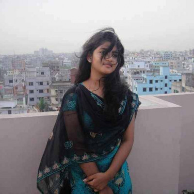 This picture shows a beautiful girl standing on the roof and it looks very beautiful and the girl's name is Shamila and a girl from Dhaka city and it is a beautiful girl from Bangladesh and the picture shows a lot of beautiful houses behind the girl and it is a picture of Dhaka city and Bangladesh  A country with a large population