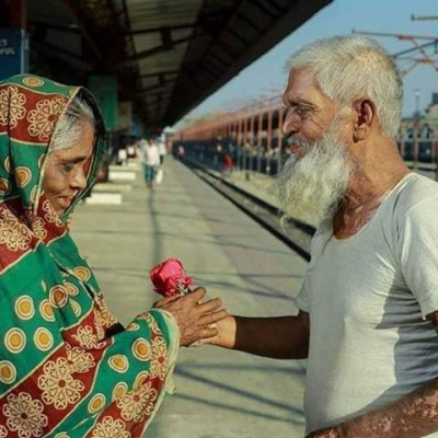 Love is in every human being.  The picture shows a grandfather giving flowers to a grandmother.  Their love is unwavering.  They have been in love since childhood and yet they love each other in old age.  That is why this grandfather is giving roses to his grandmother.