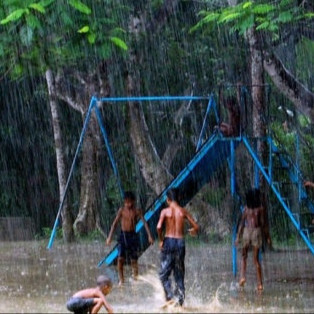 The fickleness of children in Bengal is a perpetual reality.  Children do not notice storms and rains.  This picture also bears the proof.  At a baby park in the city, they are still playing in the rain.