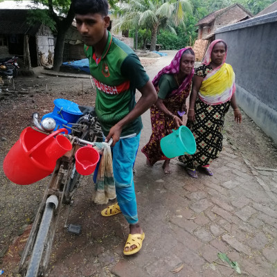 Asashuni Thana of Satkhira district sees a messenger on a rural road in Rajapur village and an envoy has come here to fetch milk and the women of the village carry two loads on a bicycle to whom the milk is brought and carry it on and on every day from 8 to 10 and as his daily labor 500 rupees is extraordinary.  Can't do a job because it's definitely harder to keep inside for the milk to stay inside The ideal food in all the types of food in the world is a lot of vitamins and nutrients in the distance. Children eat it as they grow older and their bodies become very heavy so your boys and girls should eat more tiger milk.