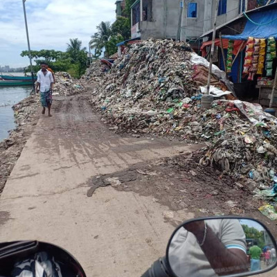 Garbage pile on Khejurbagh-Satpakhi road in Keraniganj.  Traffic has been closed for 2 years.The Khejurbagh Satpakhi road in Shubhadhya union of South Keraniganj has been dilapidated for a long time.  The road is covered with piles of garbage and mud.  As a result, the Pichdhala road has been completely closed for traffic for the last two years.  Thousands of residents of the area have suffered as a result.Traffic on the road is a long way off, it is not possible to cross on foot. Although the road was paved a few years ago, garbage from different areas of the upazila was brought in vehicles and dumped in the empty space on both sides of the road.  At one point, the rubbish began to accumulate on the road.  Gradually the whole road turned into a pile of rubbish.  All traffic on the road has been closed for two years.
