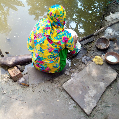 This is a very rural scene. A housewife from the village is cleaning dishes in front of a pond in their house. It is very beautiful. Here is a picture of a rural woman cleaning dishes in front of a pond.  Here is a picture of him sitting in front of the pond. He is doing the work. We see such a scene in Bangladesh. The women of the village clean the village to clean them. They clean the dishes and take them home. Here is a picture of the village.  The woman is cleaning the dishes and she is a member of the family and she does such cleaning work every day and she does all the household chores like one of the chores she is doing here is cleaning the dishes.  Cleaning dishes and it's a village scene.And the scene that has been seen here for so long is the scene of our Madhyapara village and the scene of this house in Madhyapara village where a housewife is cleaning dishes in a pond in front of the yard.