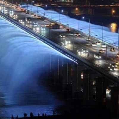 South Korea is one of the most developed countries in the world. South Korea is a developed country. The economic system of this country is much more developed. Now the picture I posted is Rainbow Fountain Banpo Bridge in South Korea. This bridge is very beautiful to look at. It was built many years ago. The Korean government built this spectacle under its own supervision. It is really beautiful to see when a car passes over this bridge. This feature is that it flows like a fountain of water on both sides. It looks very beautiful. We should visit these places of interest. It has a wide reputation as a tourist destination. Many travel thirsty people from home and abroad come here to travel. So that everyone can know about this country.
