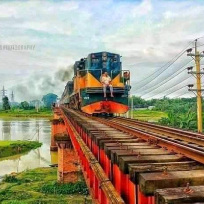 This is the picture we can see of a train line.  Let's see a train going through its line.  It looks very beautiful and extraordinary to see the picture of a man in front.  It looks to the human mind it looks amazing located in Mymensingh.  In a river or pond there are extraordinary and nice gone over.  It looks very interesting and it will fascinate people.The current line has passed by the side of this train line. The current pole can be seen and the current wire can be seen.The greenery on both sides of this train line is amazing to look at and it will captivate people.  It looks very attractive, it will deceive the hearts of the people of the country.  It will take our minds. The train line has taken shape here.  It looks very beautiful in our Mymensingh distinct   of Bangladesh.