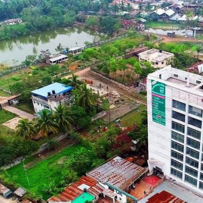 You can see a beautiful picture here.  This is a view of Buddhipur Colony area of ​​Satkhira city.  You can see the picture taken from above.  Looks so beautiful.  There is a huge building with many small houses next to it.  Manik green trees have kept the environment green. And there is a big pond in the area. You can see that the people of this area bathe in that pond and wash their necessary clothes.  Next to a slum area, there are many small houses built together, they live.  The scene looks very beautiful.  And a road has gone by its side. They walk along the road. It is a crowded area. The view is very beautiful. I hope you will like it too.