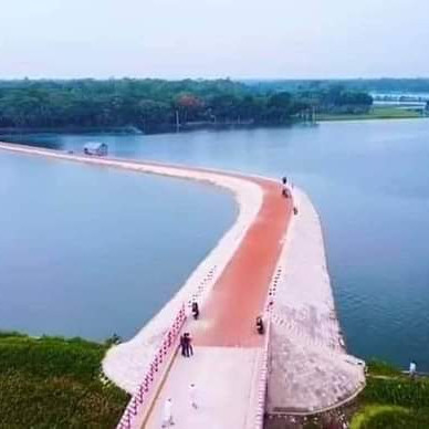 What beautiful pictures you can see here.  It is a mini park. It has been turned into a beautiful place by building a beautiful bridge over it. Visitors come on top of this bridge and enjoy the beauty of nature.  That is why visitors flock here. It is located in the North Matlab area of ​​Chandpur district. It is beautifully decorated.  That is the most beautiful place. You are looking at this picture.