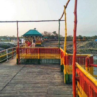 This picture shows Khulna Russell Ecopark. It is located on the banks of the river Rupsha. It looks very beautiful. This ecopark is a common park in Khulna.  The various attractions of this park and the view of the river Rupsha inside it is very beautiful. Russell Eco Park along the river Rupsha is a very beautiful park in Khulna district which you can see in this picture and it looks very beautiful and this is the picture that you see.  Khulna is getting itNot people from Khulna district but people from different districts come to visit this Russell Eco Park and it is very special as it is on the banks of Rupsha river and it is seen in this picture and it is seen that it will probably be light and this is what makes Russell Ecopark beautiful on the banks of Rupsha river.  Made and this picture shows that the seating area inside the park is very nicely made on the banks of this river and they look very nice as you can see there.