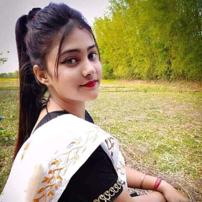 There is a very beautiful girl sitting here and this girl is my big sister and she looks very wonderful sitting in the middle of a field.  This thing looks very beautiful. Today I got a new sari and after the sari I gave my big sister a pick. The picture of my big sister looks amazing.
